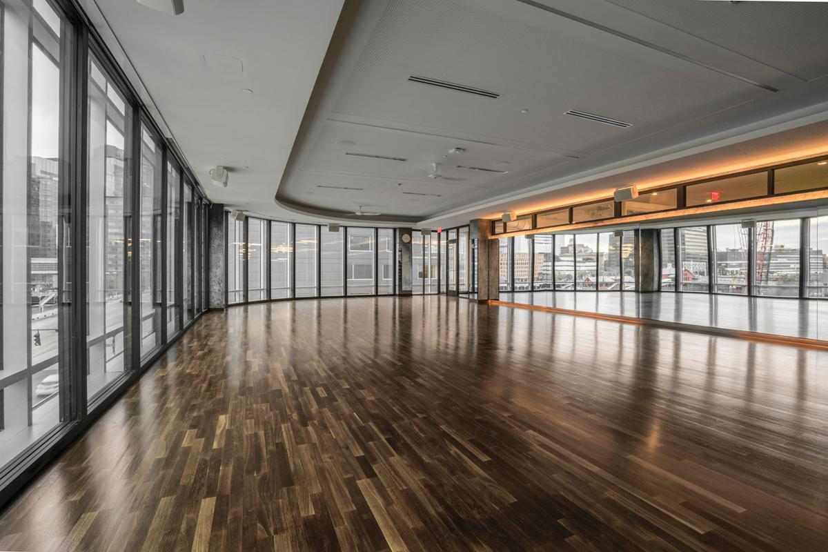The 35,000sq ft (3,252sq m) club sits on Boston Harbour and has been designed with black granite, exposed steel, black oak and polished wooden floors / Ian Travis Barnard
