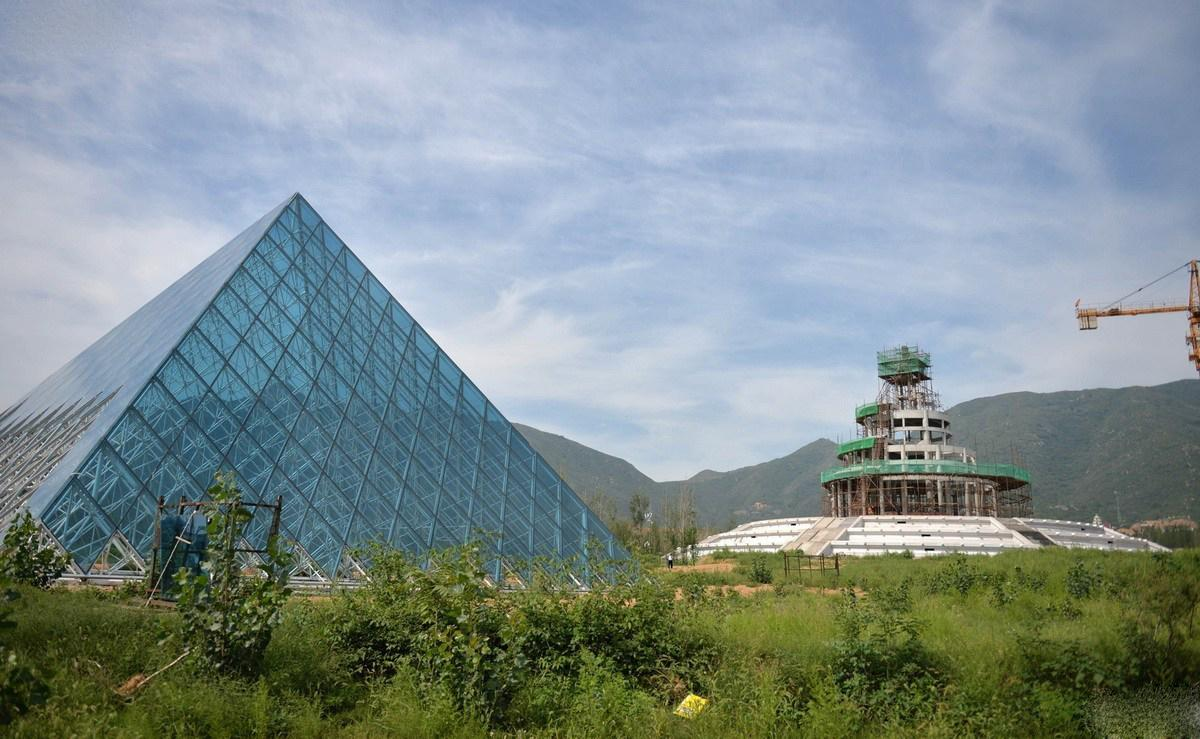 The replica Louvre sits in an overgrown field of the unique amusement park