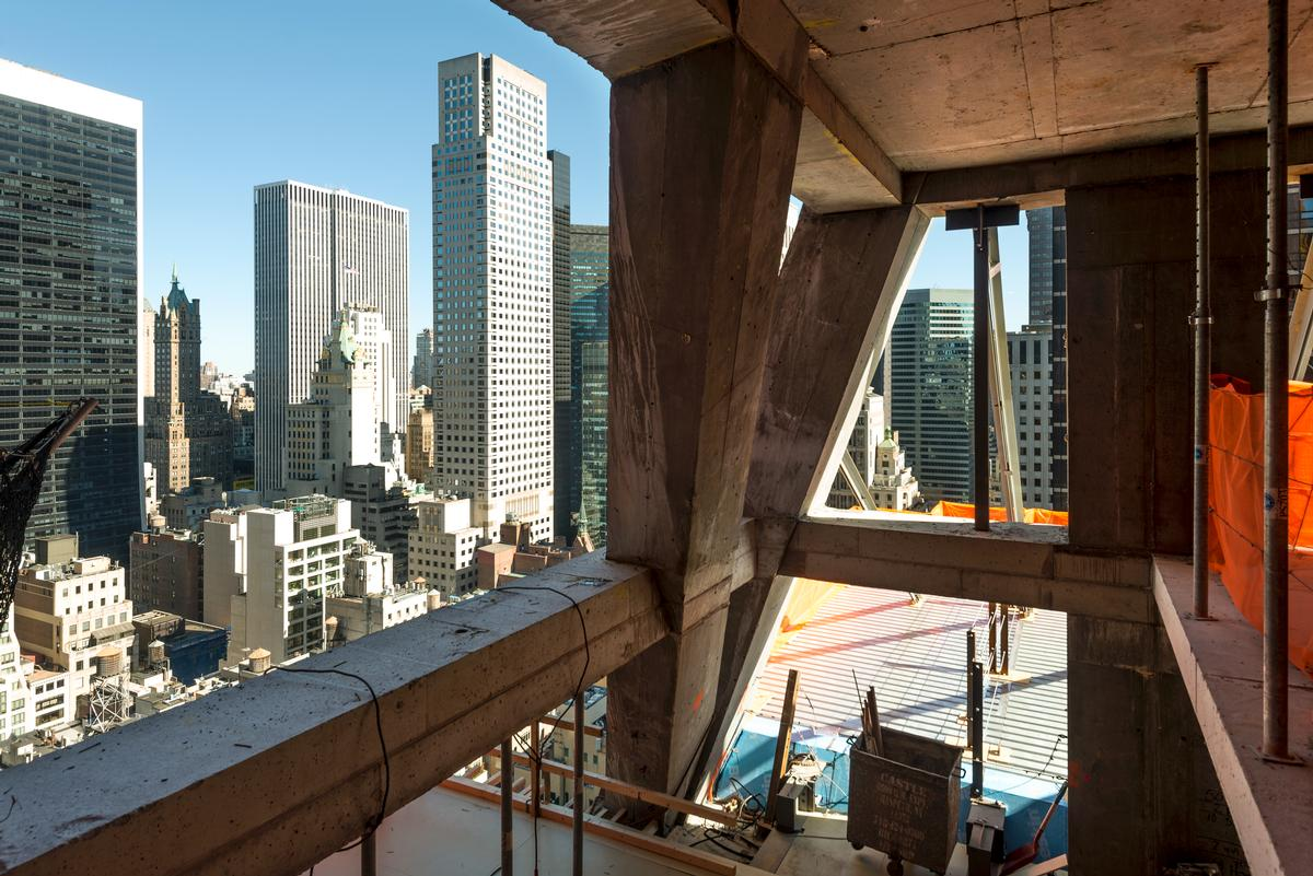 The building has been designed around an angular framework of naked concrete, and an exposed structural system, referred to by Nouvel as the diagrid / Giles Ashford