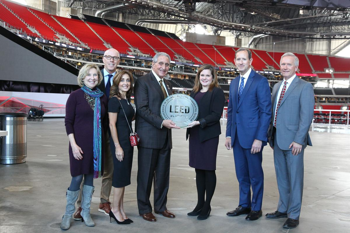Receiving the certification (left to right): Penny McPhee, Rich McKay, Angie Blank, Arthur Blank, Shelby Buso, Paul Bowers, Scott Jenkins / HOK