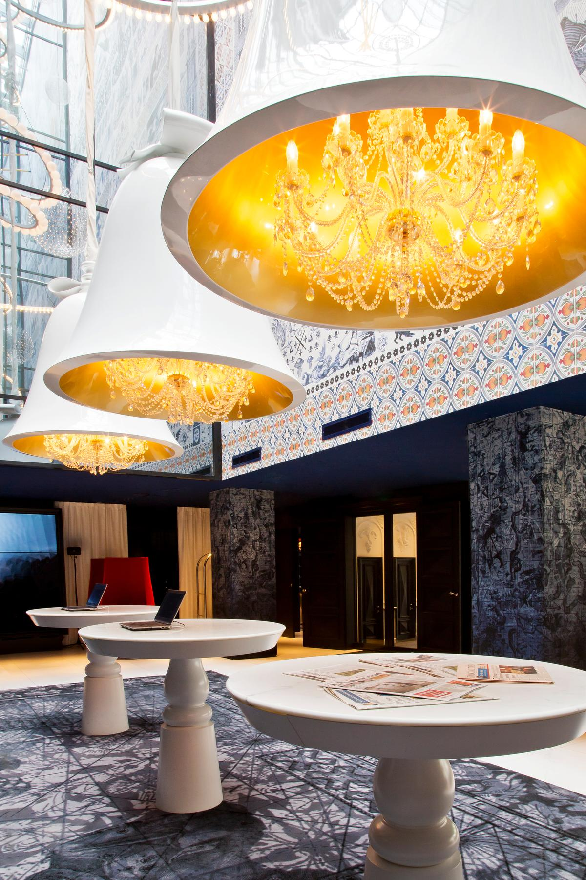 The Andaz Amsterdam Prinsengracht's oversized bells, passion red Tulip Chairs, and walls showing ancient nautical maps reference the Dutch Golden Age / Andaz Amsterdam/Marcel Wanders