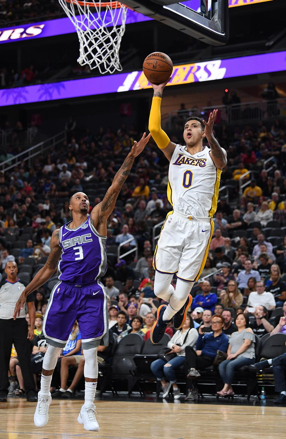 Los Angeles Lakers forward Kyle Kuzma shoots the ball against Sacramento Kings guard George Hill  / © USA TODAY Sports/SIPA USA/PA Images