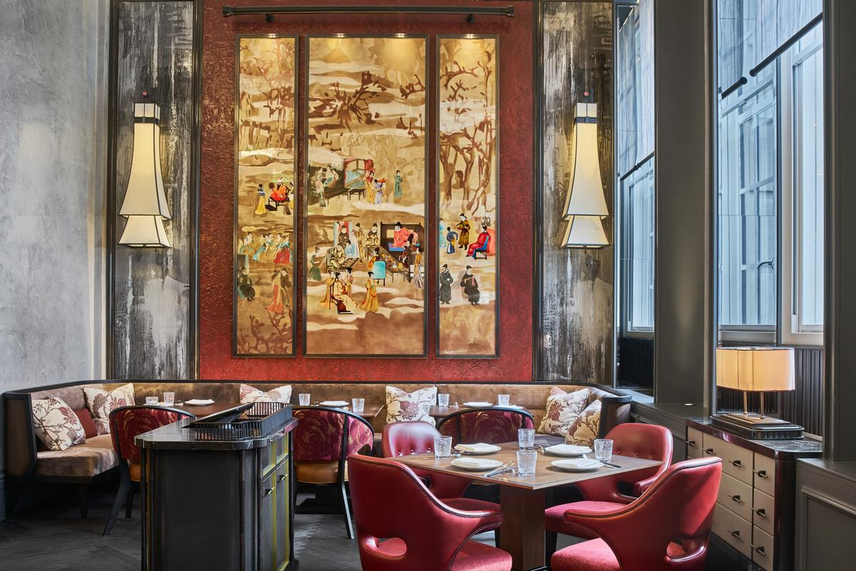 The restaurant's central focal point is a red lacquer frame holding an ornate three-layer gilded triptych / AB Concept