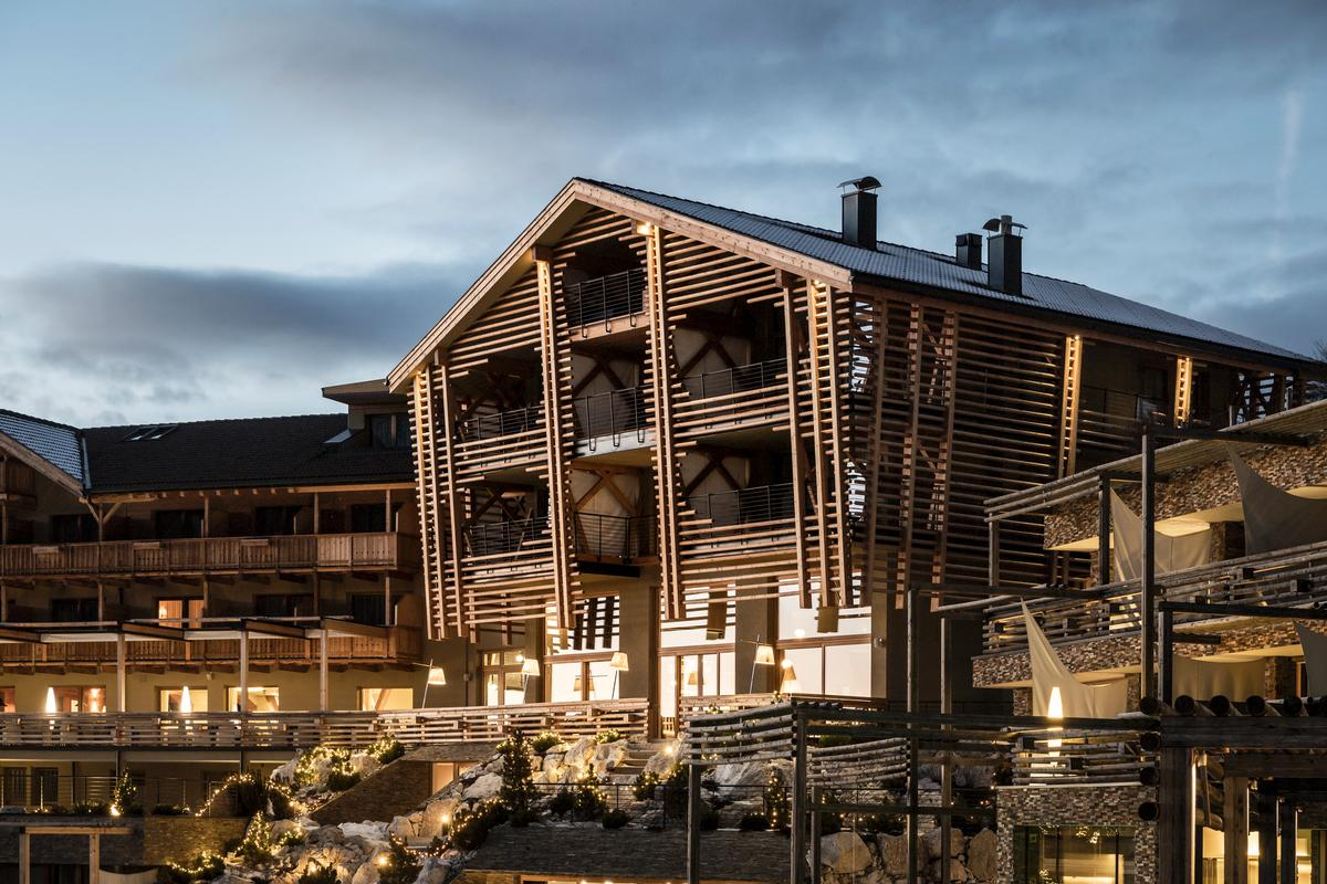 The building's wooden facade is inspired by the region's typical farmhouses of the area, with irregular recesses in the horizontal wooden panels allowing sufficient daylight to penetrate into the rooms behind / noa*