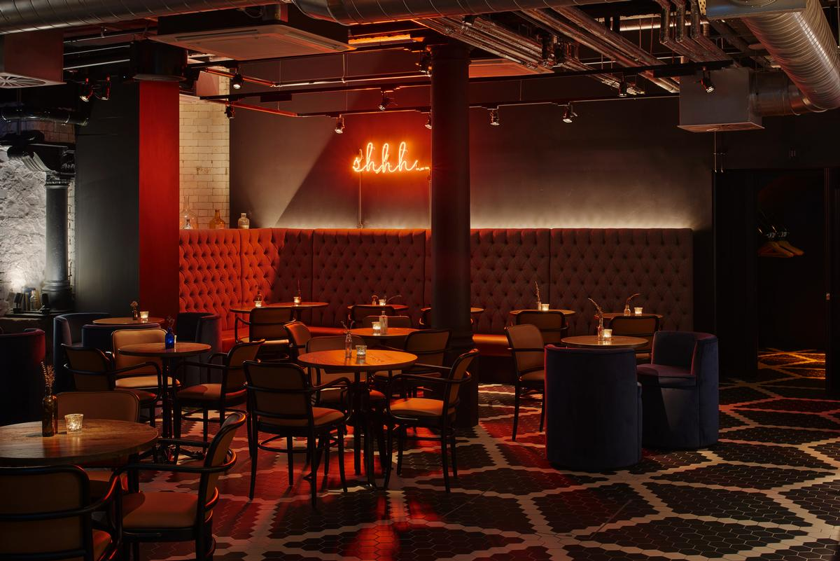 Conceived as a hidden speakeasy serving 60 types of gin, diners must enter Alston Bar & Beef via a discrete entrance / Jestico + Whiles