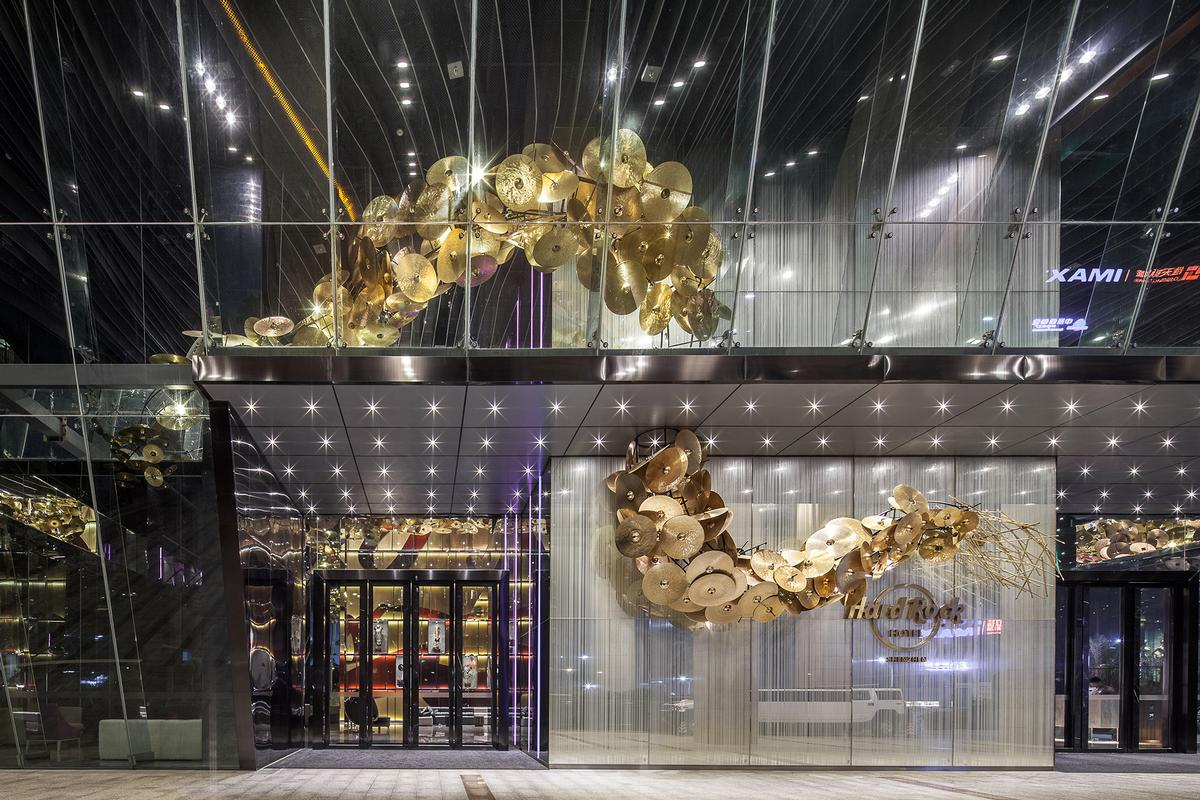 A golden dragon made from drumsticks and 1,680 cymbals dominates the lobby / Nirut Benjabanpot
