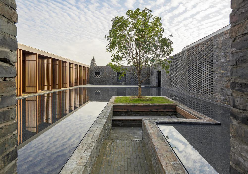 At the Tsingpu Yangzhou Retreat, reclaimed brick walls create multiple courtyard enclosures