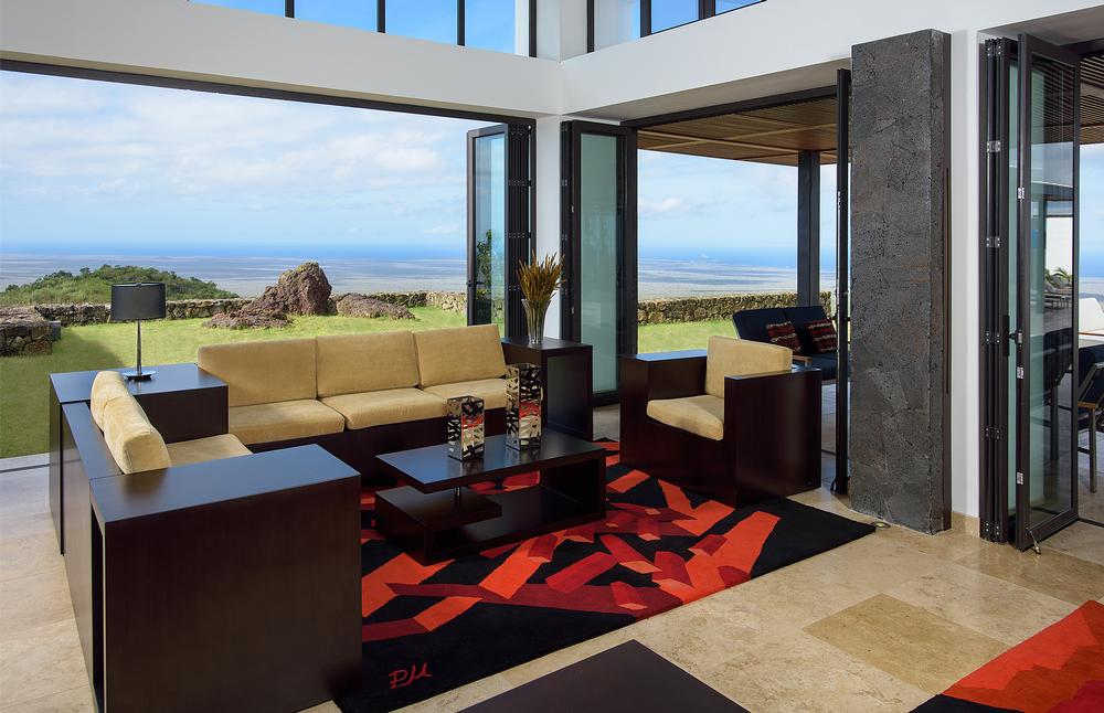 The interiors are modern and sleek. Large windows and doors allow the views to take centre stage