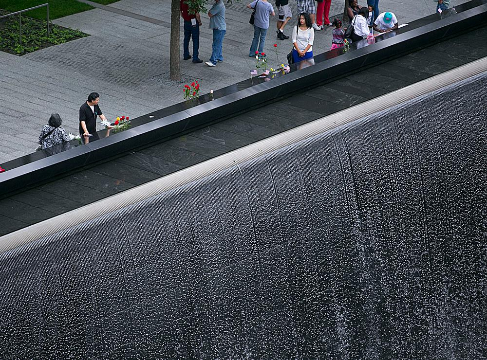 Victims' names carved around the edges of two acre-sized waterfall pools at the Memorial Plaza / PHOTOs: © JIN LEE