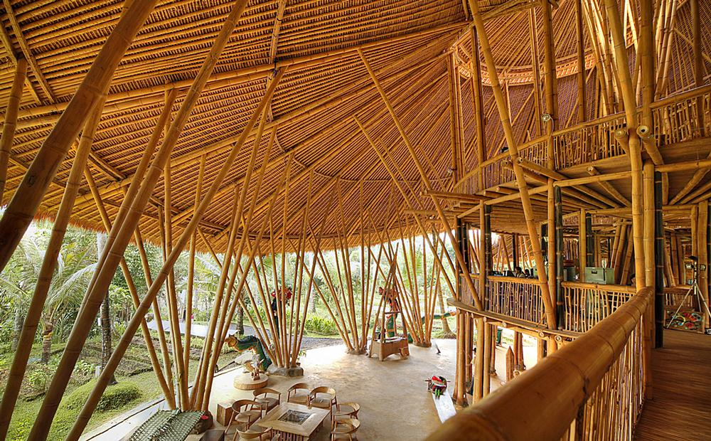 The spiralling Heart of School building forms the centerpiece of the Green School. Children learn in open sided, bamboo classrooms