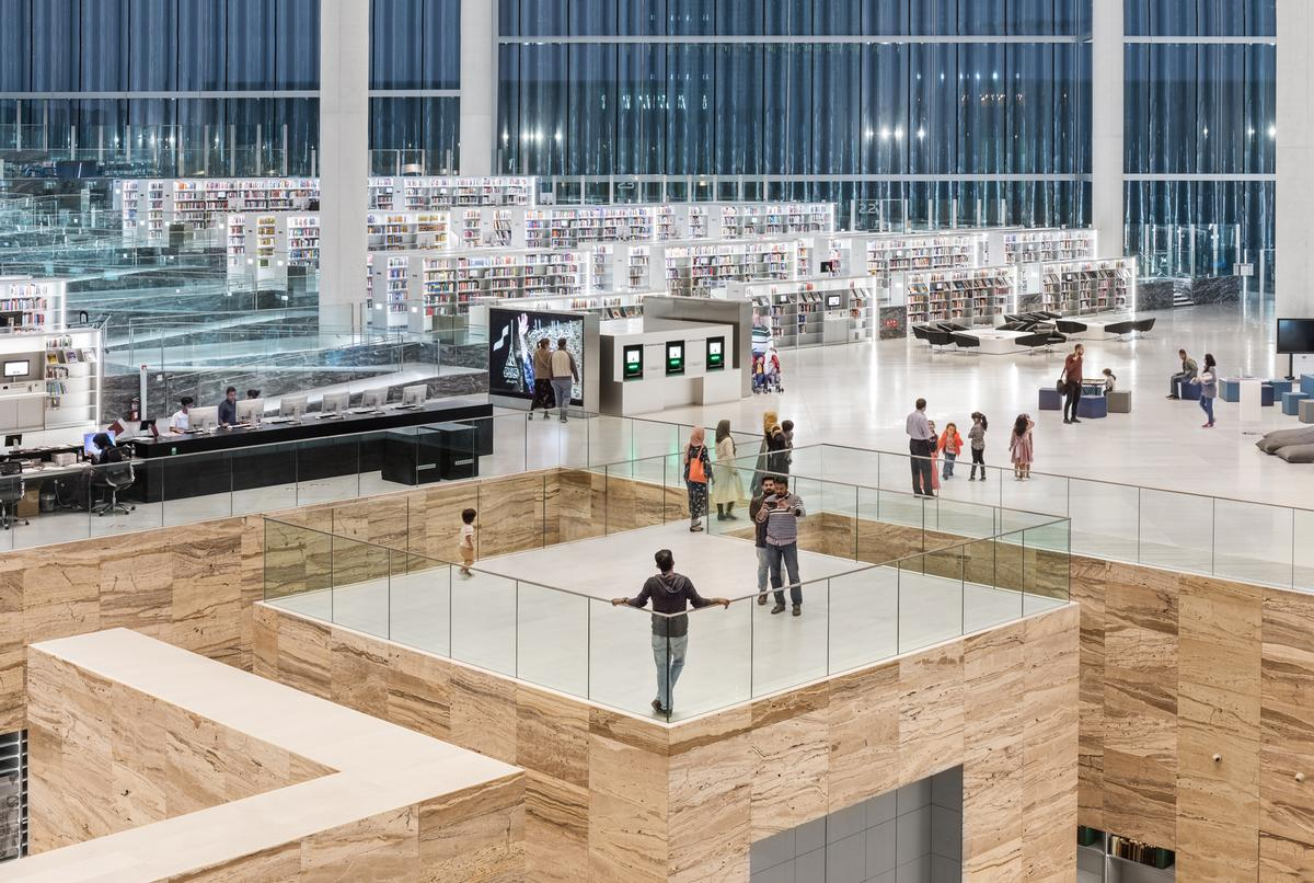 In the centre of the library, a six-metre-deep excavated-like space houses the heritage collection of valuable texts and manuscripts / Delfino Sisto Legnani and Marco Cappelletti, courtesy of OMA