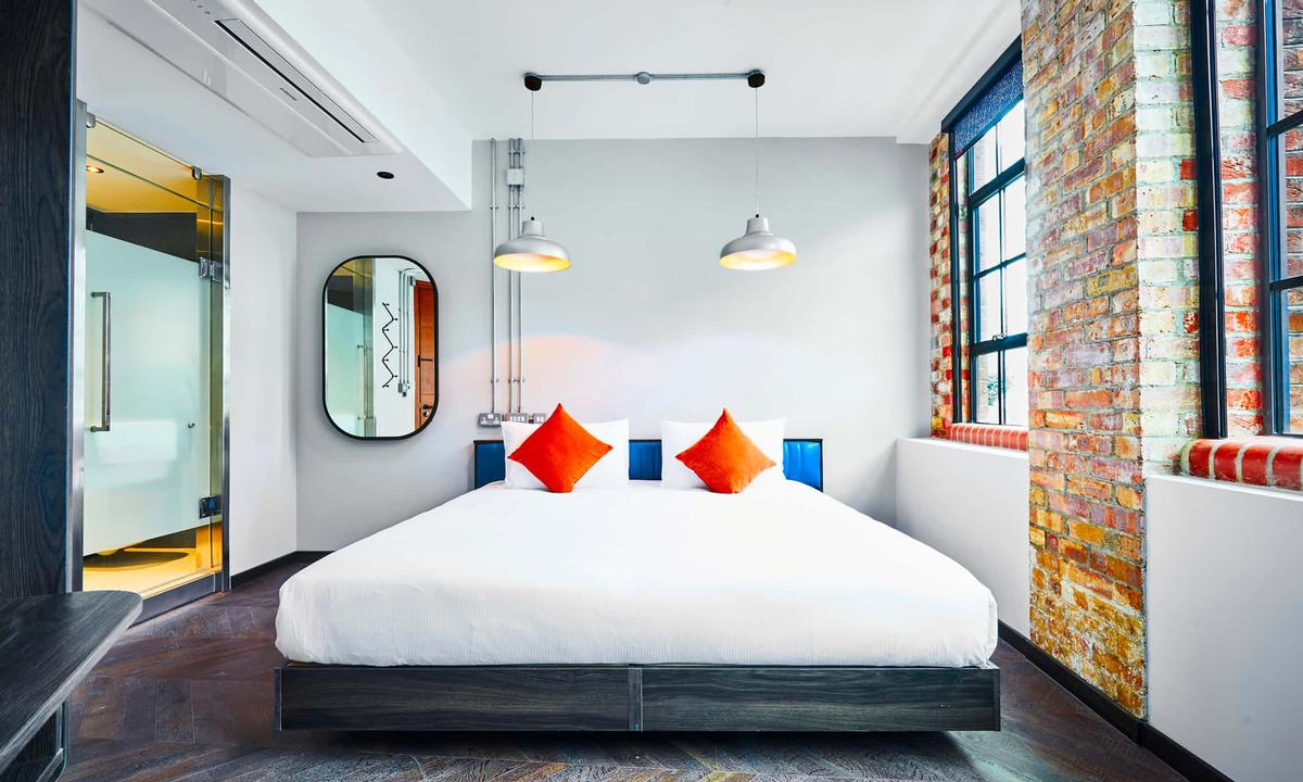 The design of the 80-bedroom hotel pays homage to the building's history as a textile factory / New Road Hotel
