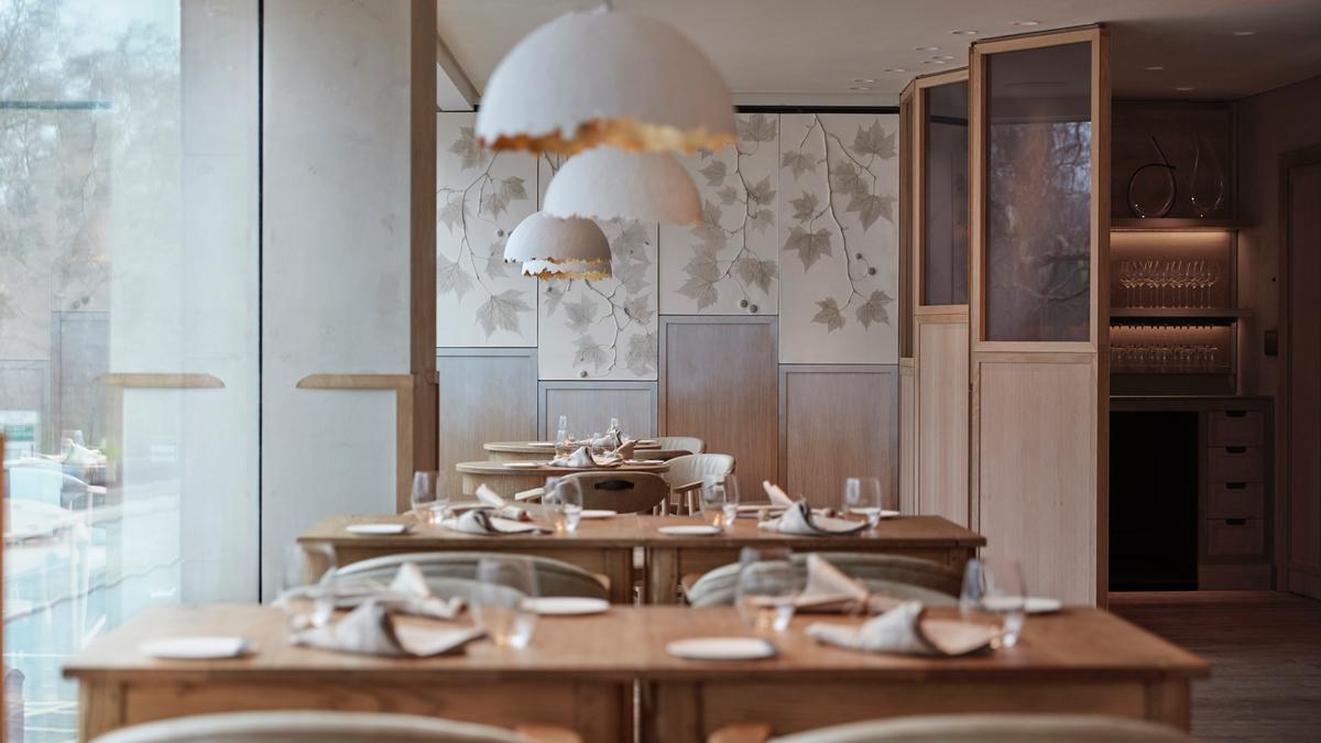 Decorative pendants hang above the tables, which cast a softly-focused warm white glow / Joakim Blockstrom