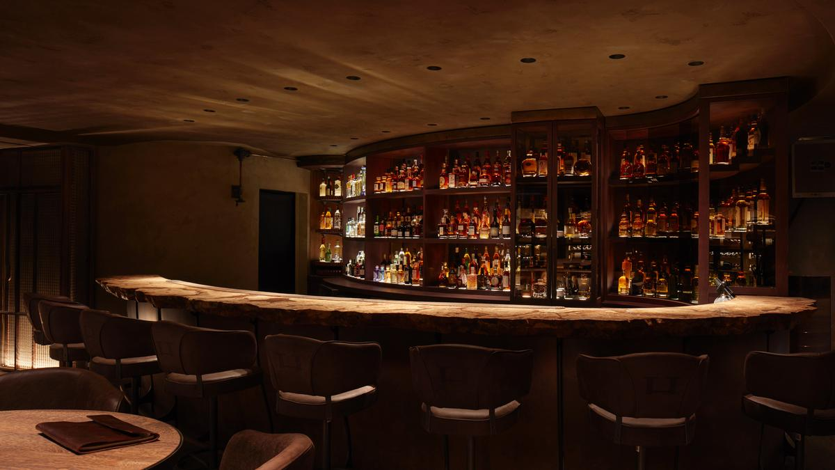 The basement bar features low light levels to nurture a sense of intimacy and emphasise the bar tops and drinks display / Joakim Blockstrom