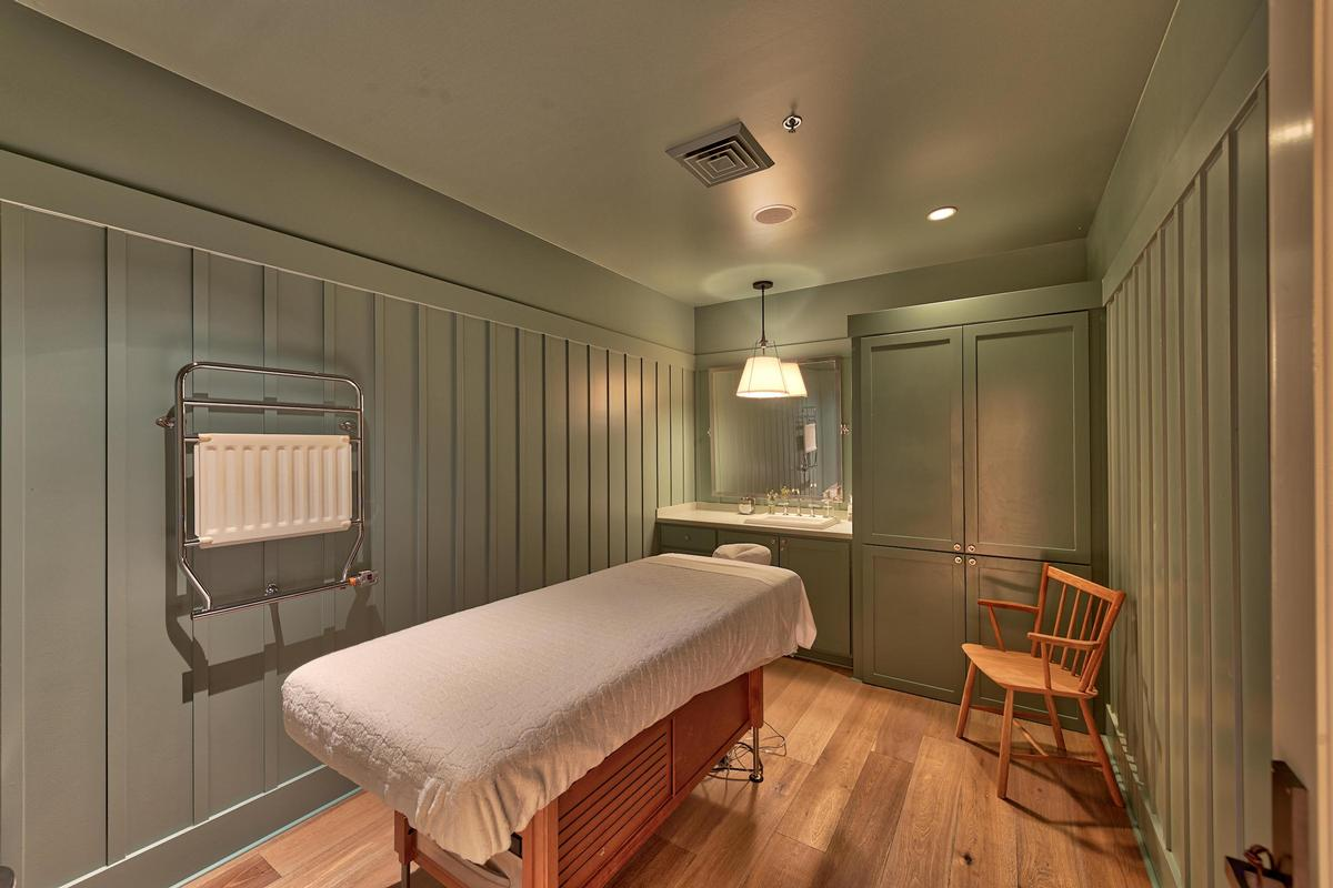 Each treatment room is outfitted with light wood flooring, new massage tables, furnishings and equipment, and coloured with deep green tones