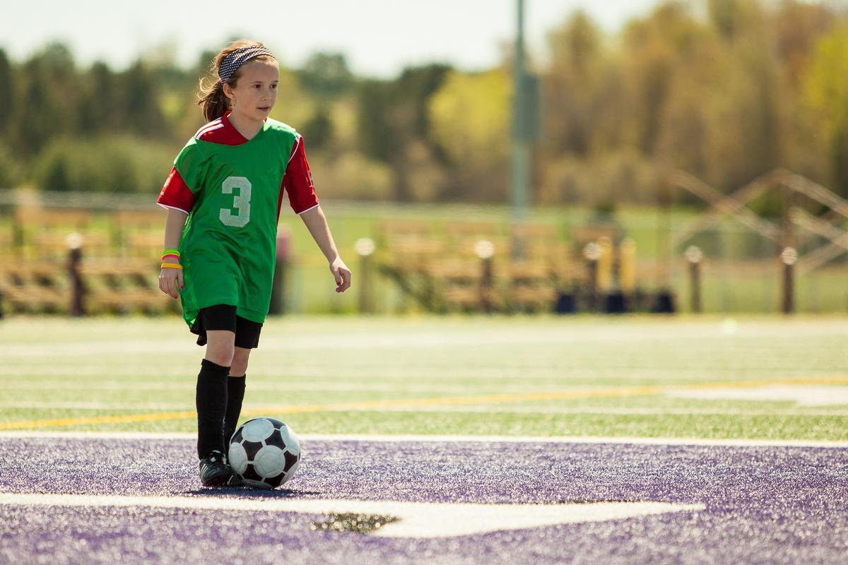 While dads are generally happier than mums for their daughters to get involved in football, younger mums are most likely to disagree that 'football is a sport for boys' / Shutterstock