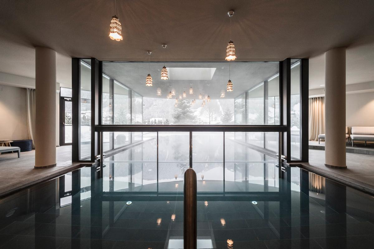Hotel features include an Asian themed library, an open-air lounge and an indoor-outdoor pool