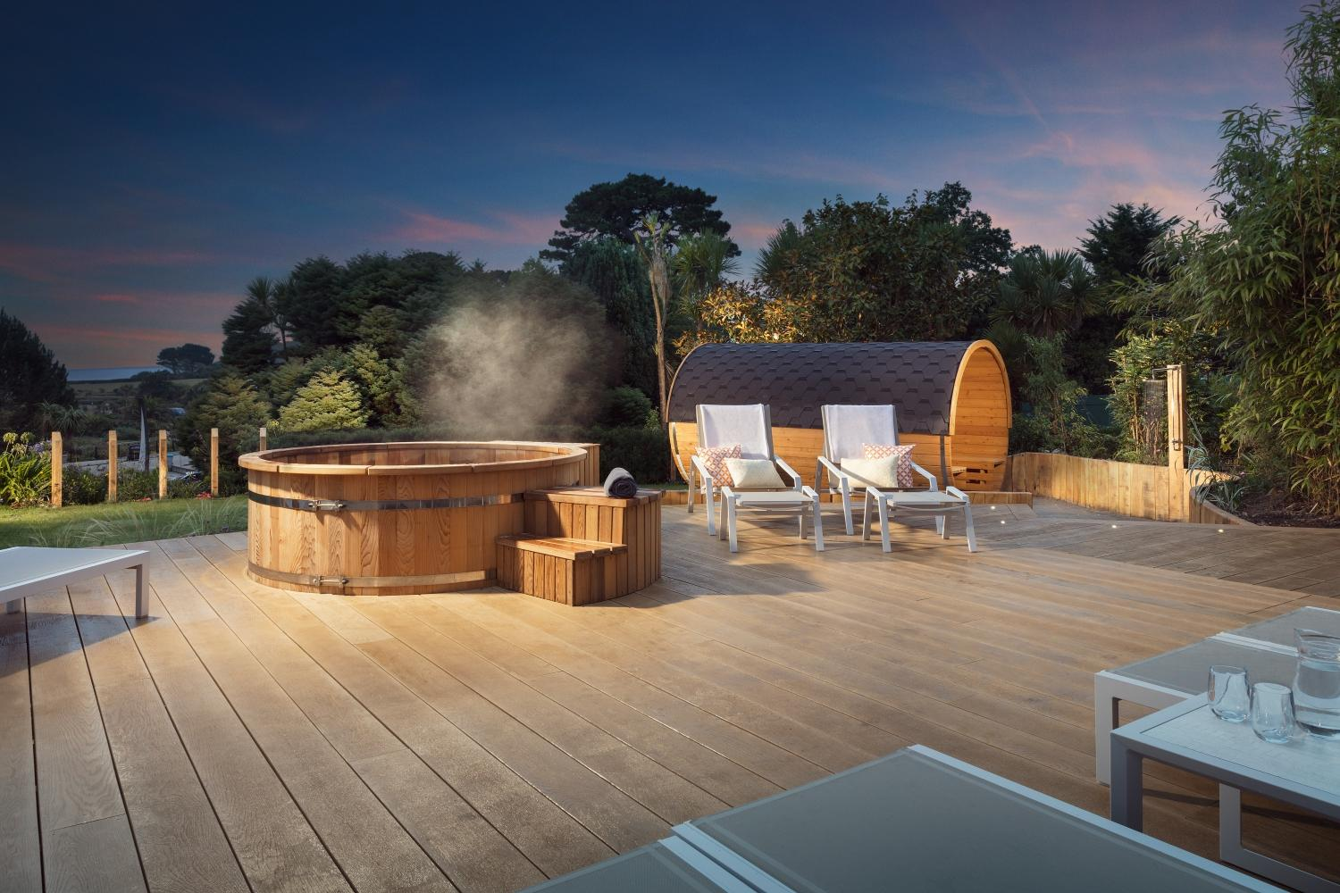 Outdoor facilities include a sun deck, a barrel sauna offering sea views and a red cedar-wood hot tub