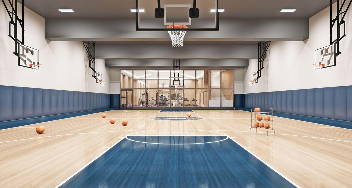 A full size basketball court is shared by residents of three residential towers, all by signature architects