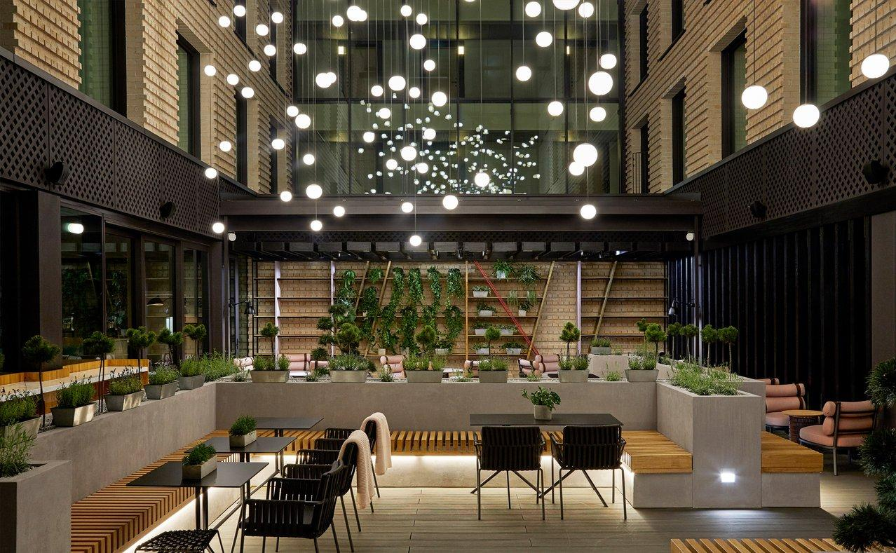 Facilities and leisure spaces include a restaurant, bar, lounge area, café, bakery, gym, and spa. / Courtesy of Anna Stathaki