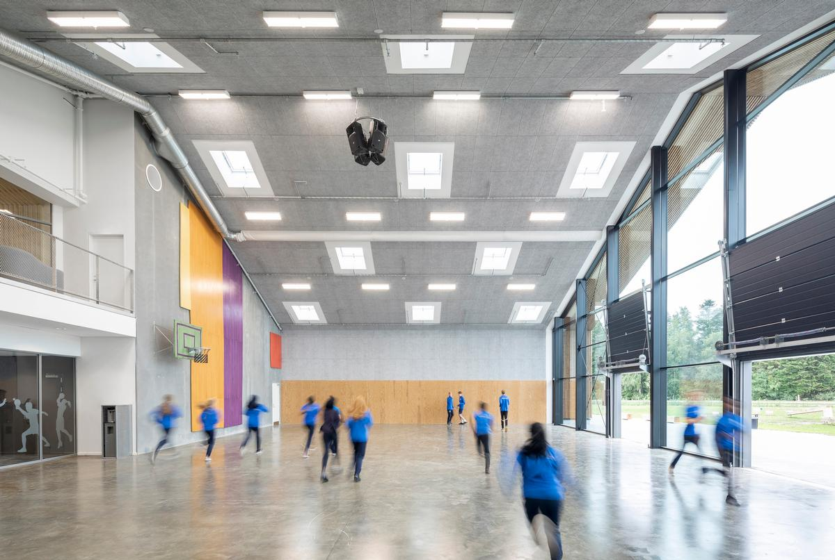Interior amenities include multiple spaces for sports, meditation, and cultural events / Photos by Adam Mørk