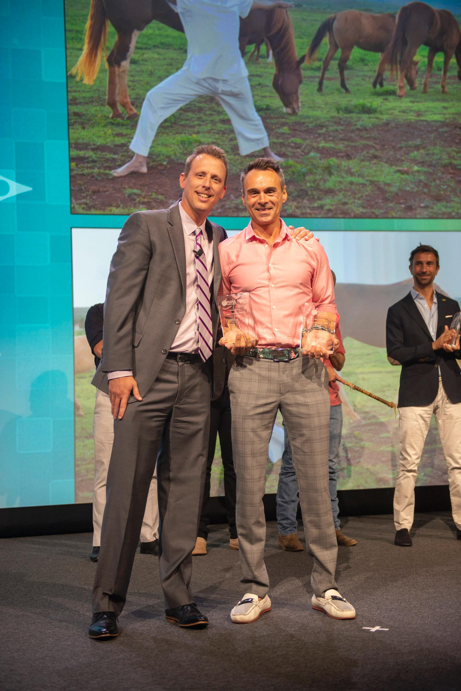 Shaw Cote, spa director at Four Seasons Resort Lana'i, accepts the award on stage with ISPA chair Garrett Mersberger