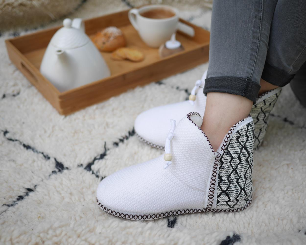 The slippers feature an innovative lining that aids relaxation and nourishes the skin