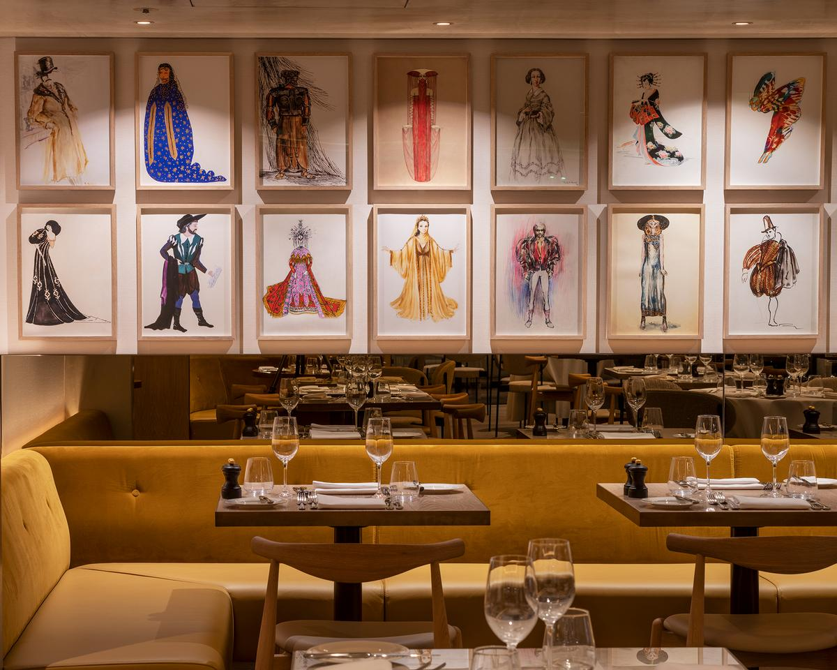 Colourful illustrations of theatrical characters adorn the restaurant's walls. / Courtesy of Royal Opera House/ Image by James Newton
