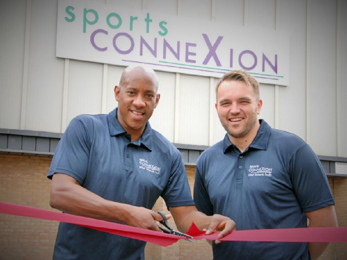 Dion Dublin (left) does the honours with Sports ConneXion gym manager Simon Taylor