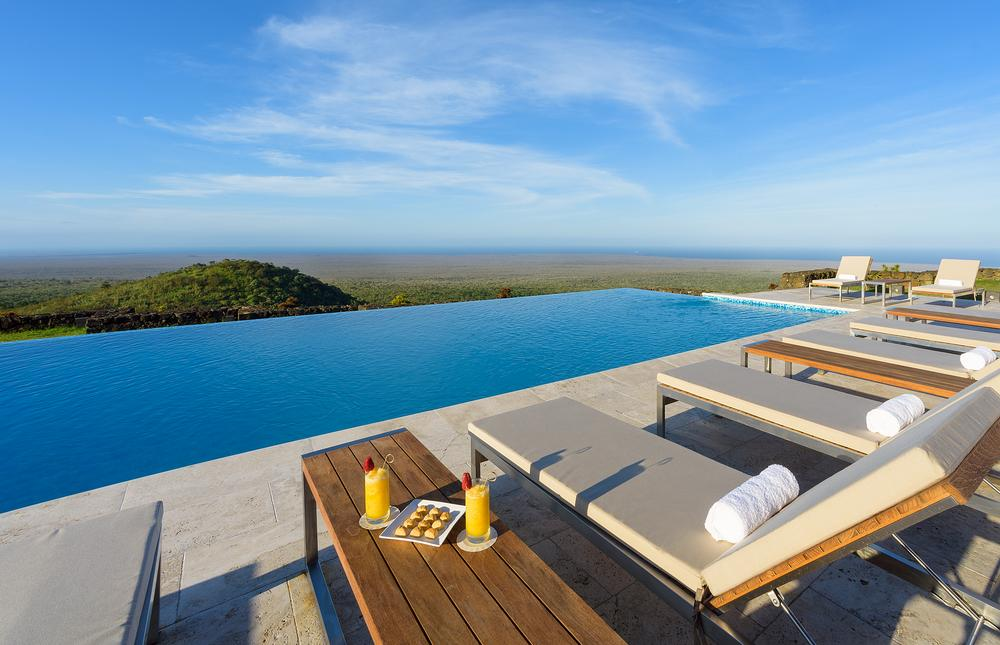 The hotel features an infinity pool, a restaurant, a bar, a spa and – more unusually – a giant tortoise reserve
