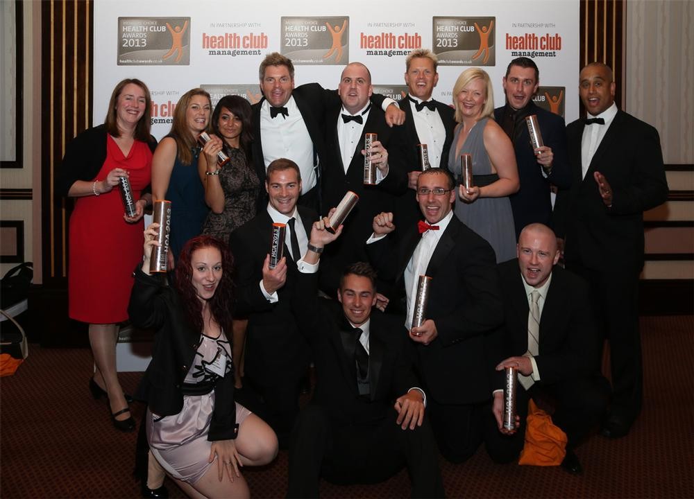 Livingwell team celebrates its awards with Mark Durden-Smith