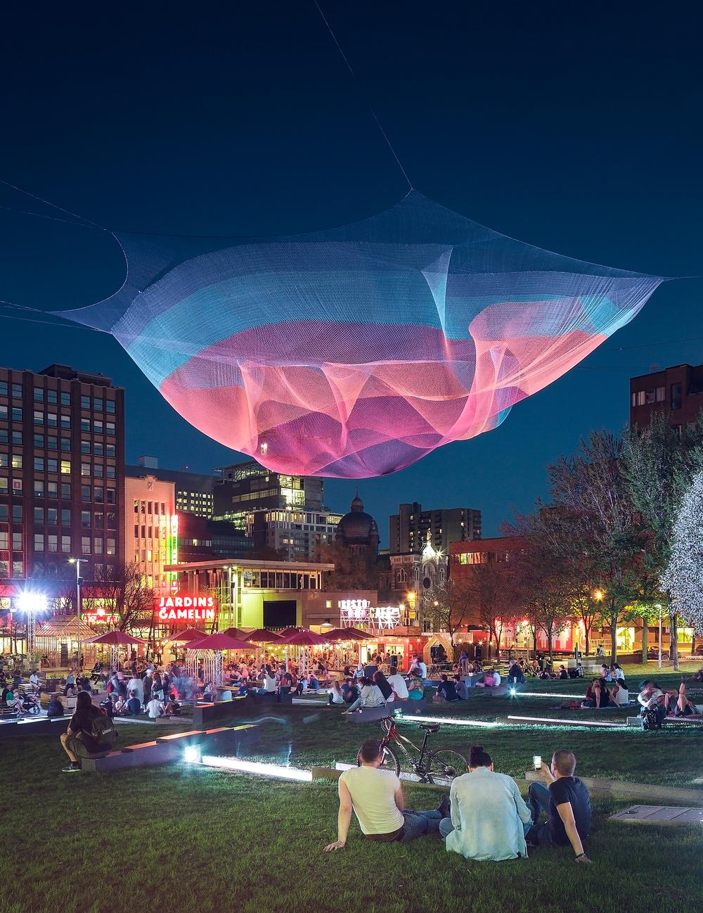 The open air bar/event space Jardins Gamelin features an illuminated suspended sculpture  / Ulysse Lemerise OSA