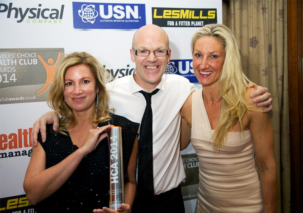 Emma Edwards and Steve Bradley of Fitness4less receive the Best Medium Chain Gold Award from sponsor Physical Company
