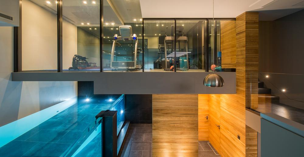 The gym sits on a glass floor over the lap pool, giving great views while working out