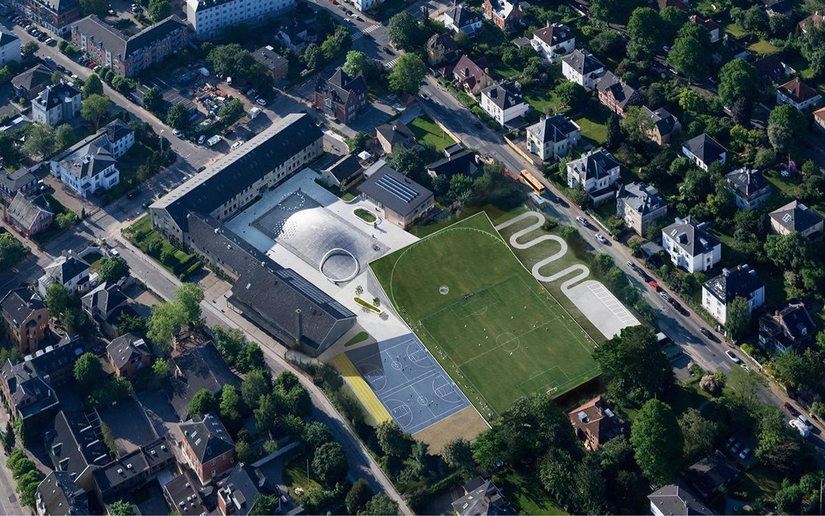 BIG installed a sports hall and arts building at Gammel Hellerup High School in Copenhagen