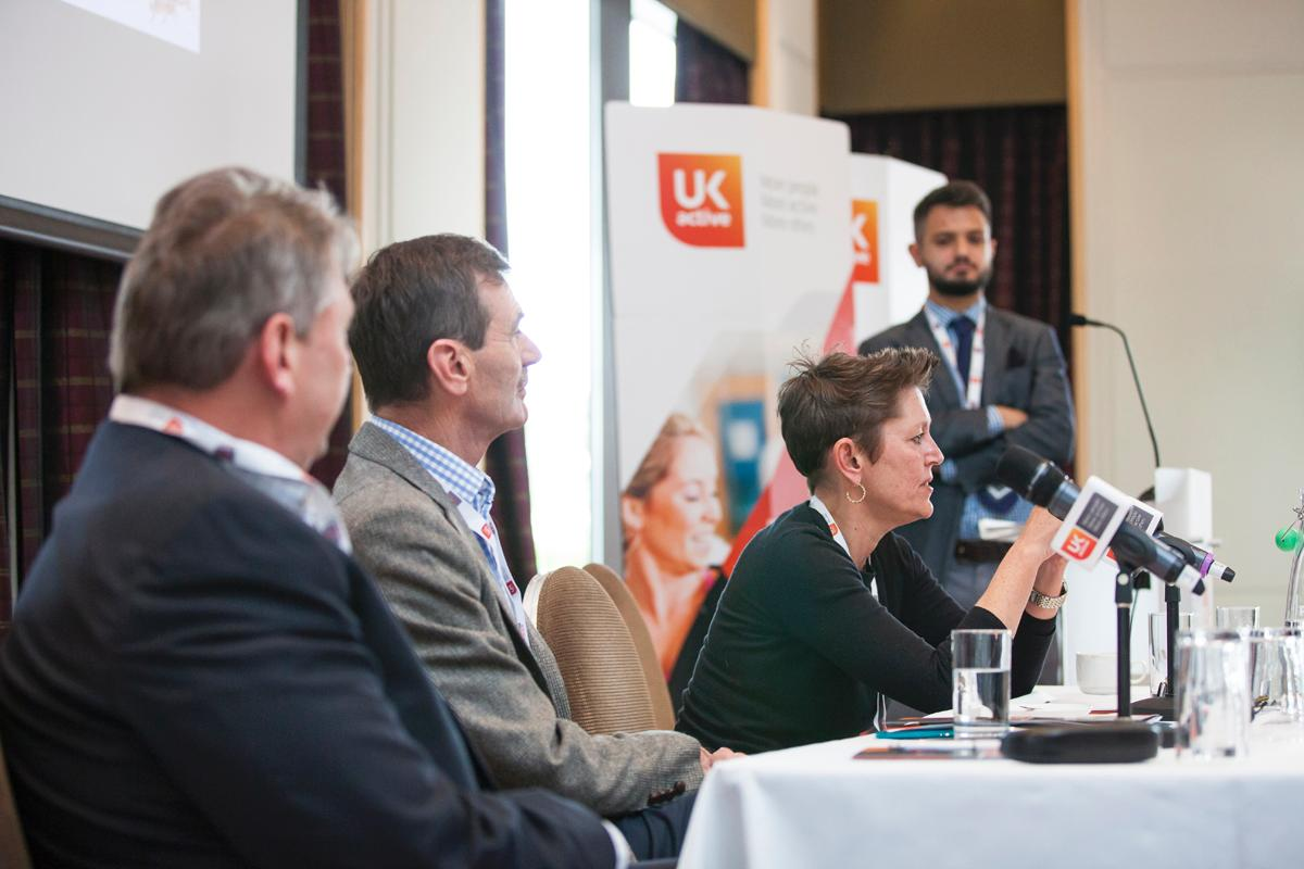(From left) ukactive CEO David Stalker and SkillsActive CEO Ian Taylor look on as CIMSPA chief Tara Dillon speaks at the Active Training Conference / ukactive