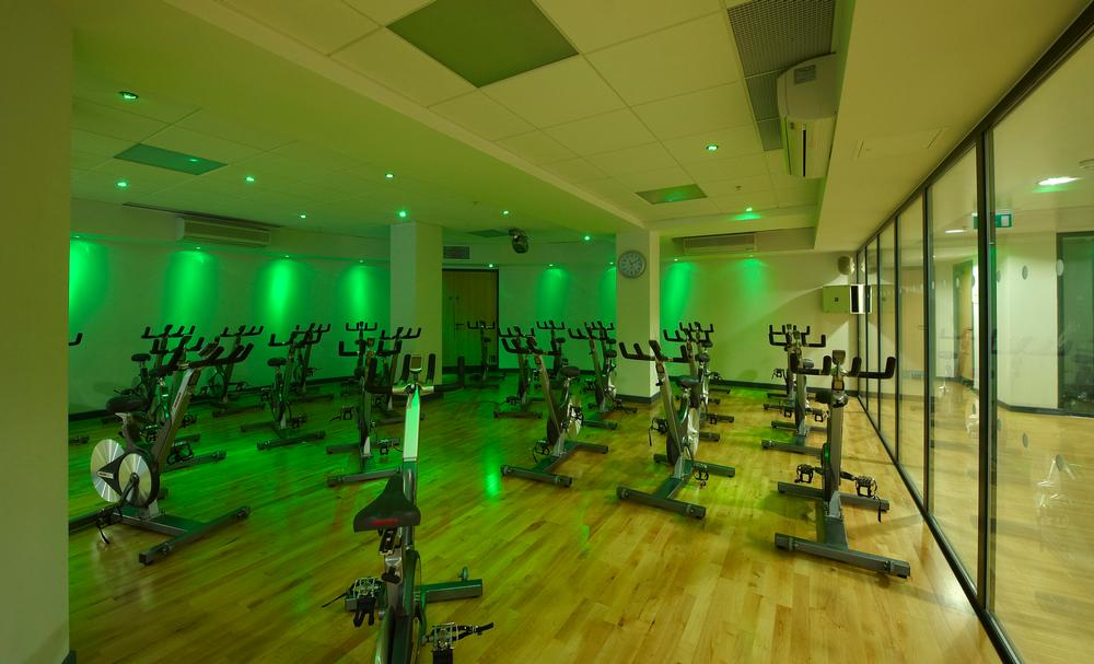 Lighting and a glass wall create 'theatre' in Central YMCA's group cycling studio