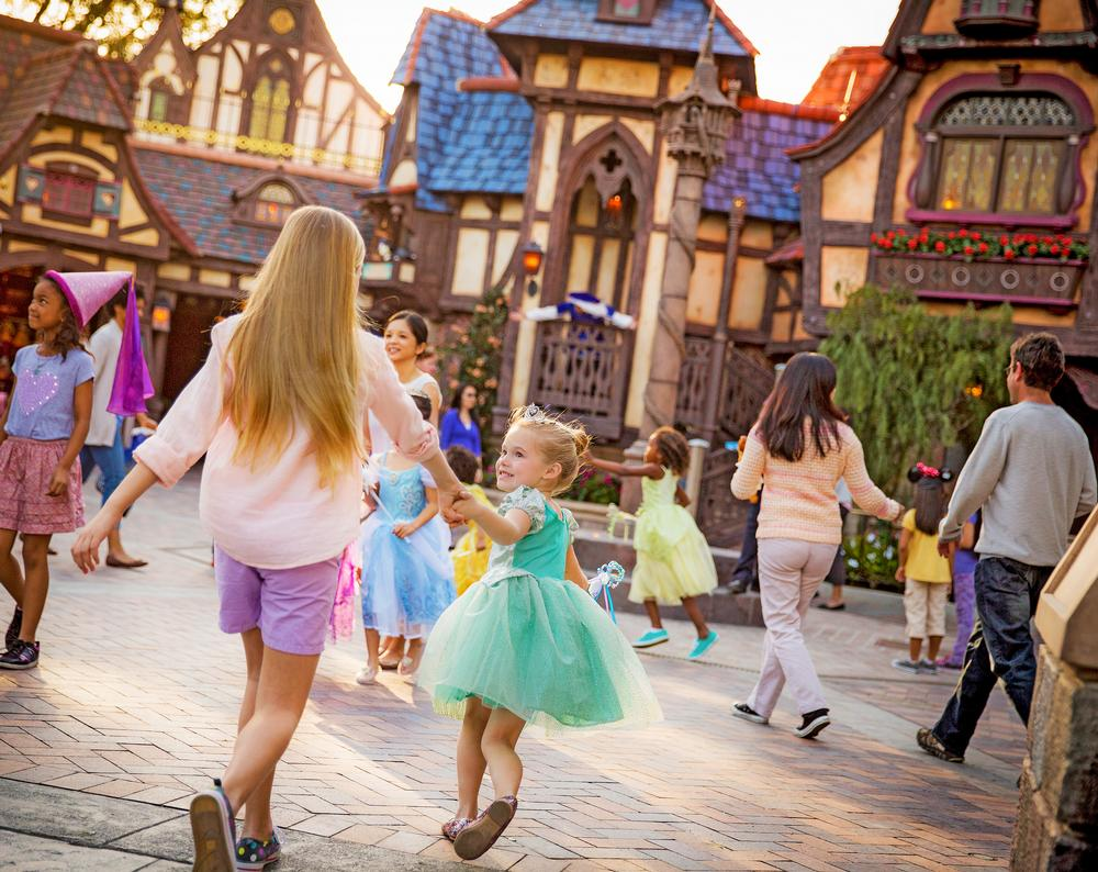 Girls rush to Fantasy Faire at Disneyland, where guests can meet the Disney princesses