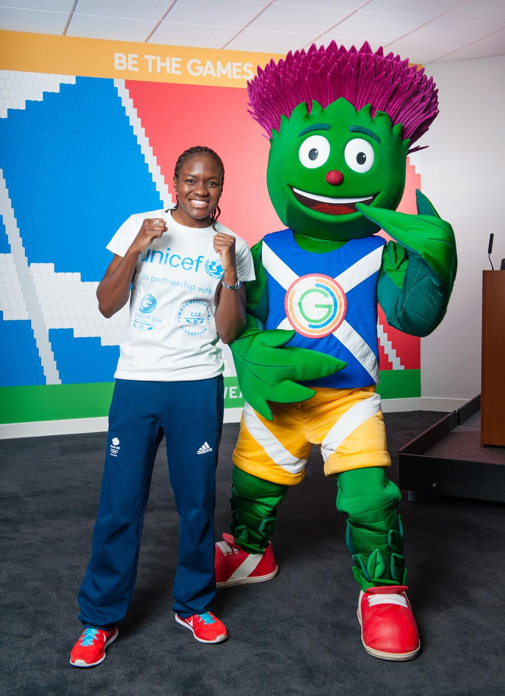 The Games' official mascot, Clyde, with Olympic boxing champion Nicola Adams