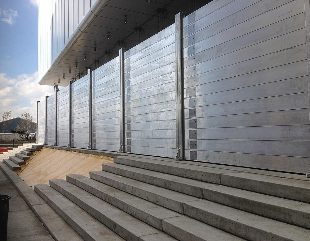 A wall of aluminium 'logs' can be deployed if flooding is expected to protect the lobby's large expanses of glass walls