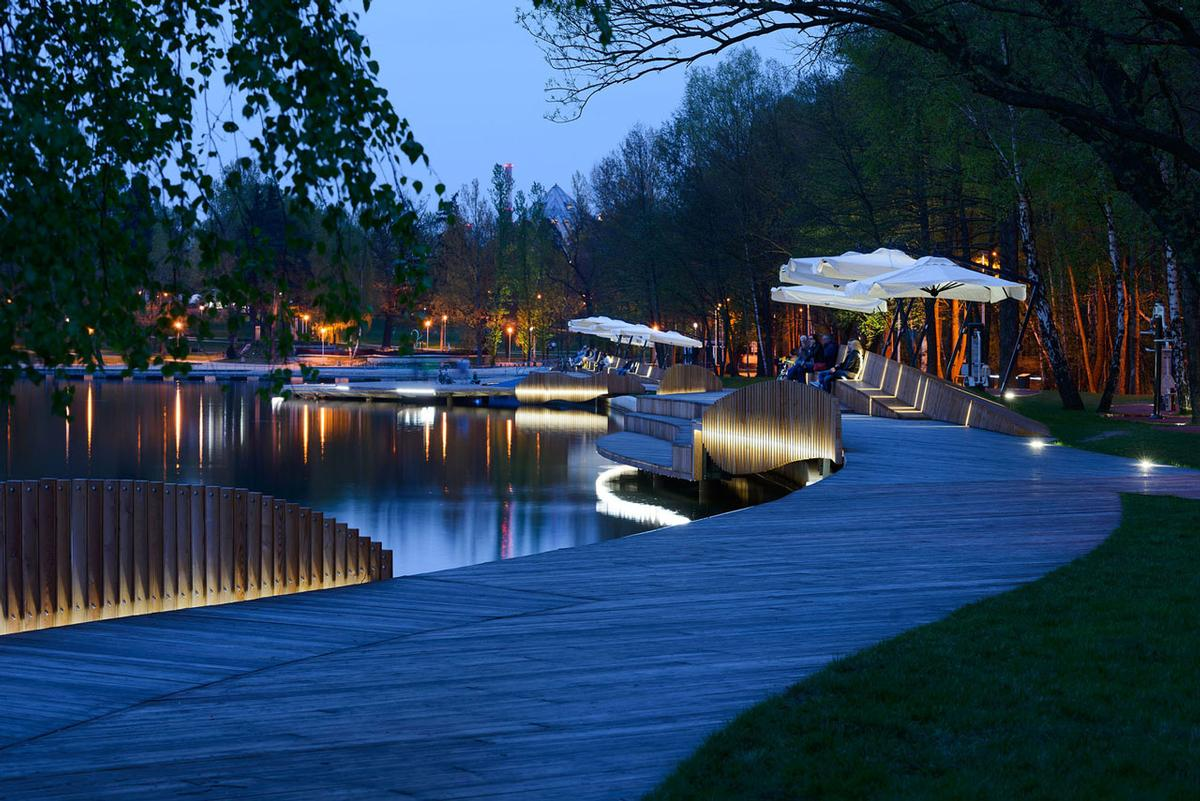 Skitek said: 'Paprocany Lake is loved by citizens. Now they have a new space directly on the water and they like to use it at any time. It is a really good working public space' / Tomasz Zakrzewski / archifolio.pl