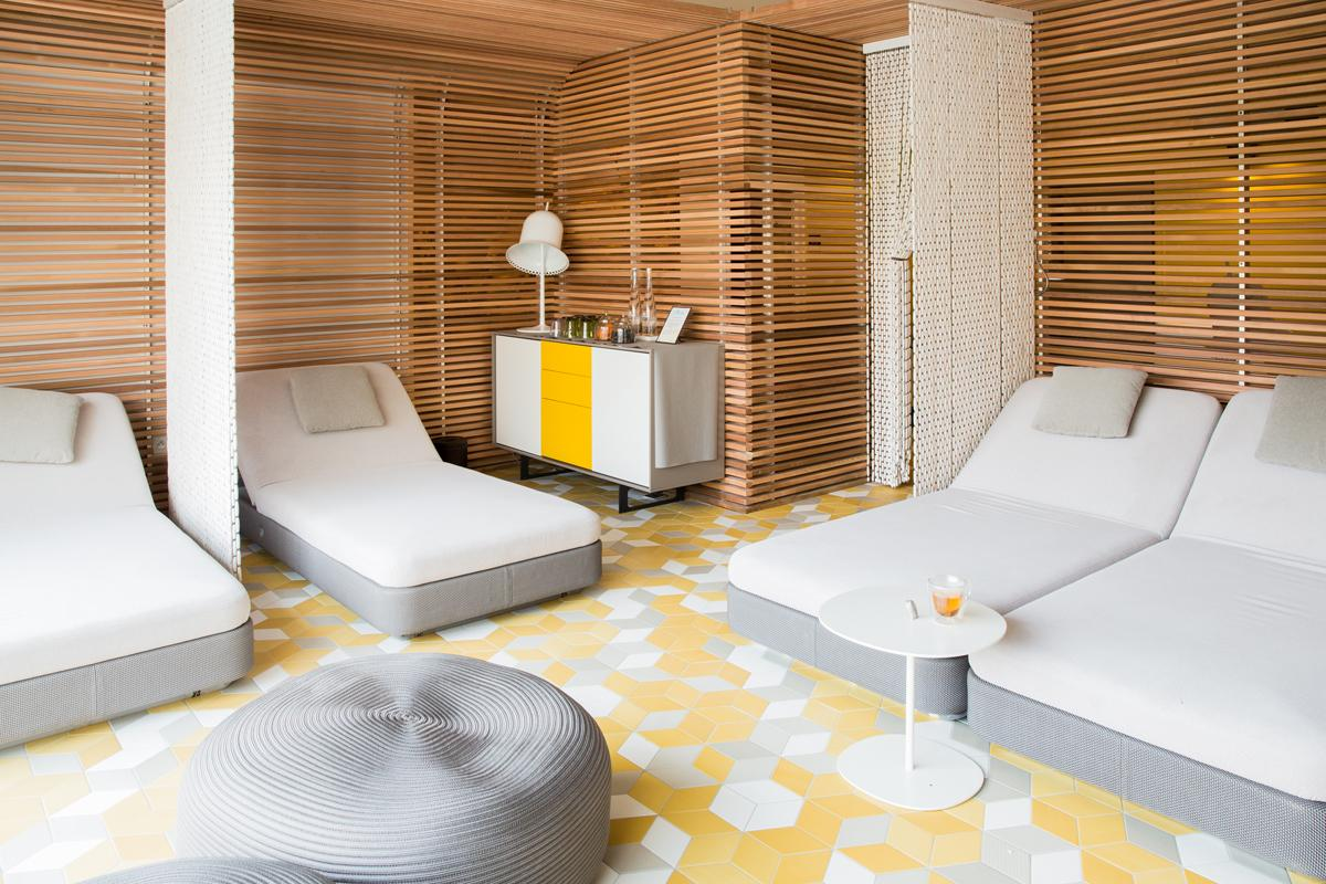 There is a high-ceilinged tisanerie at the heart of the wellness sanctuary / L'Occitane