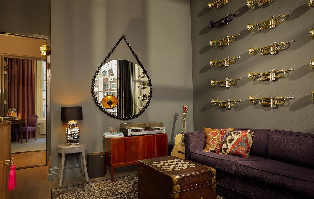 The Music Collector's Suite features a huge collection of LP records and a vintage record player