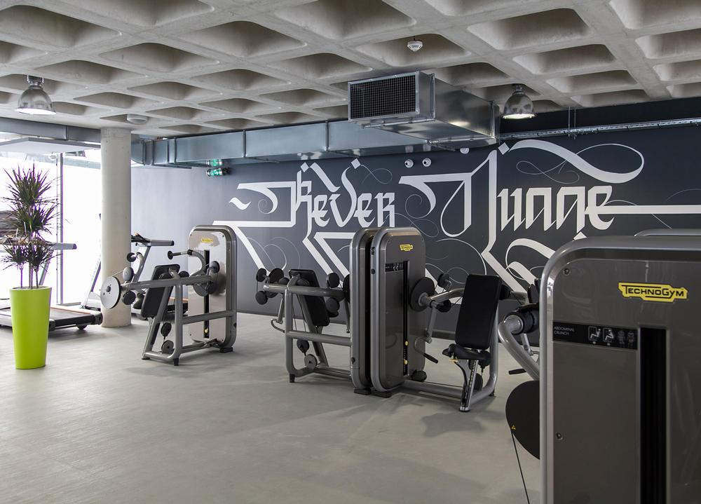 The minimalist, industrial-style gym features equipment from Technogym