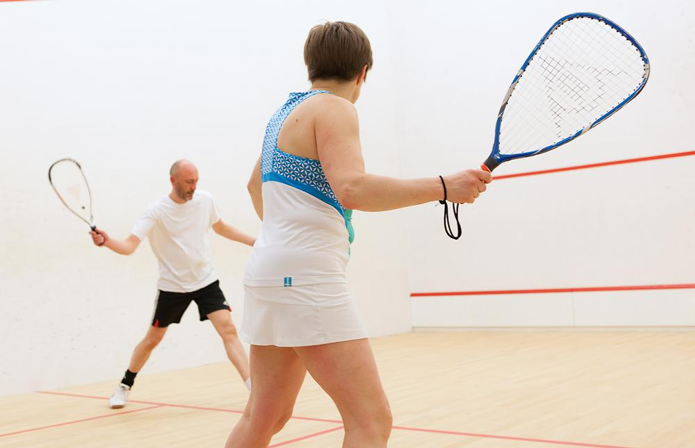 ?Squash57 – formerly racketball – is played with a larger racket head and a bigger, bouncier ball
