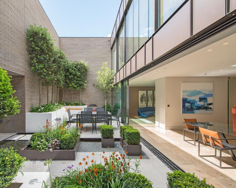 The indoor/outdoor reception spaces bring planting and fresh air into the heart of the home