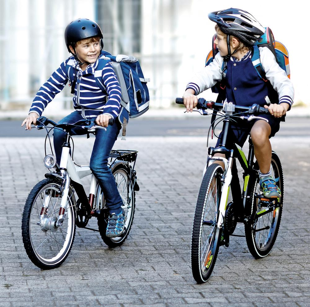The Healthy New Towns have bike trails, bike lockers and cycle to school routes / Romrodphoto /shutterstock