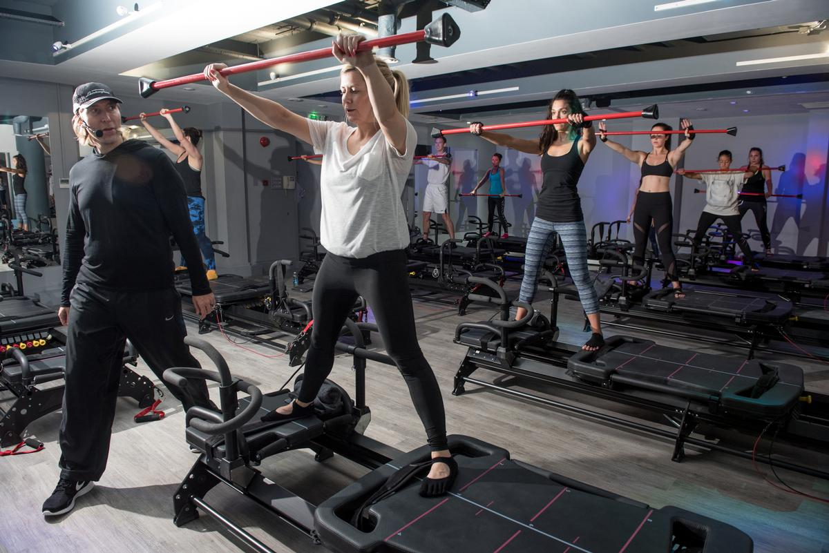 Lagree Fitness classes take place on Megaformers – resistance machines specially designed by the concept's founder, Sebastien Lagree (left)