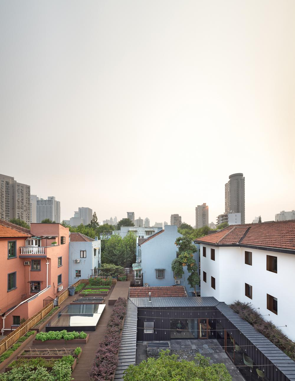 The building, with its urban farm, is nestled into a popular residential area of Shanghai
