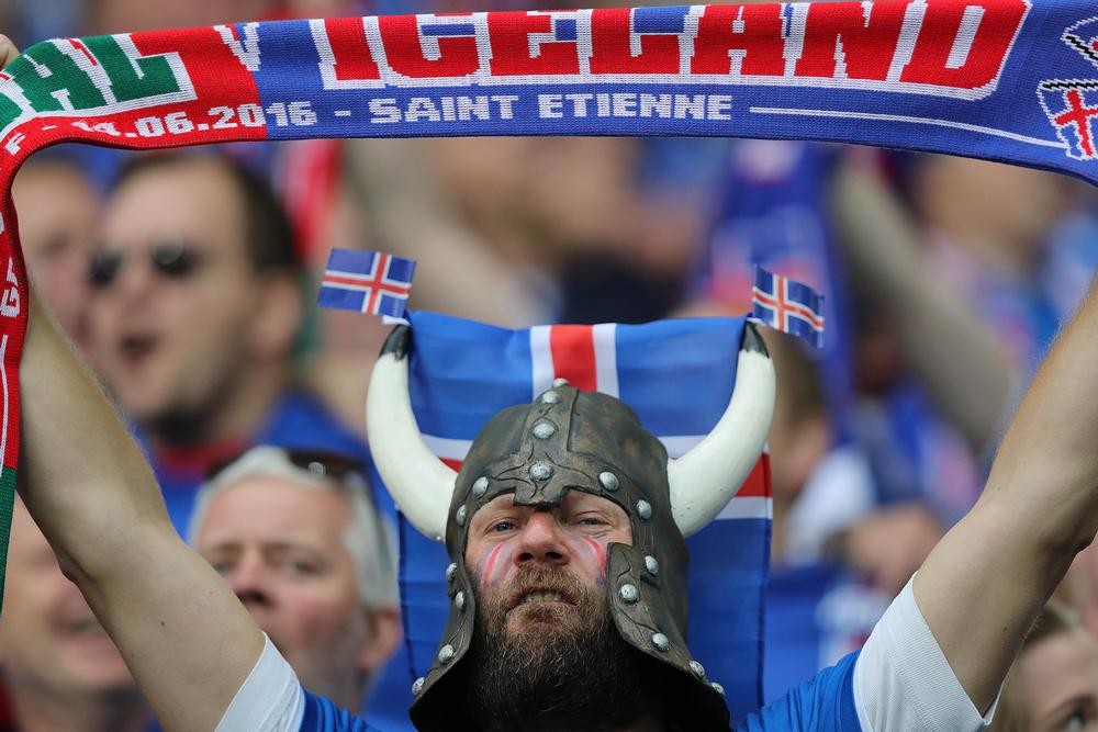 A passionate Iceland fan cheers on the national team